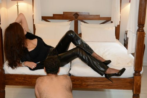 Anna Fatale posing in bed with slave fetish