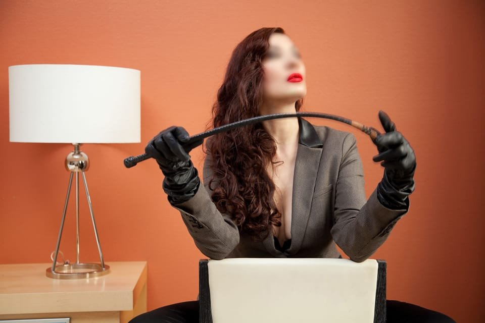 Berlin Mistress Anna Dominatrix with a whip.